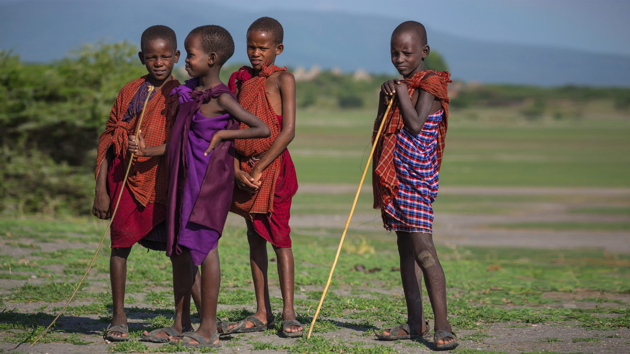 On the fringes of a dried-up lake, We encountered these four boys who were herding cattle. Even though they were young, In some families, these boys will take responsibility for all of the families' precious livestock.