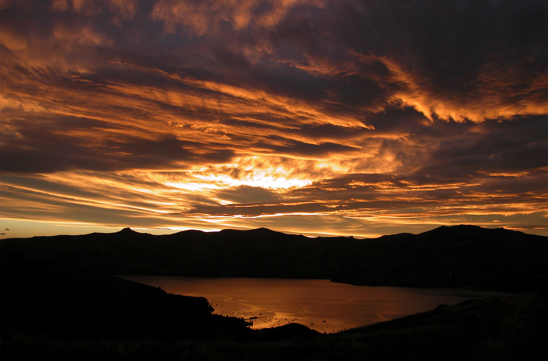Sunset over Akaroa in New Zealand's South Island.