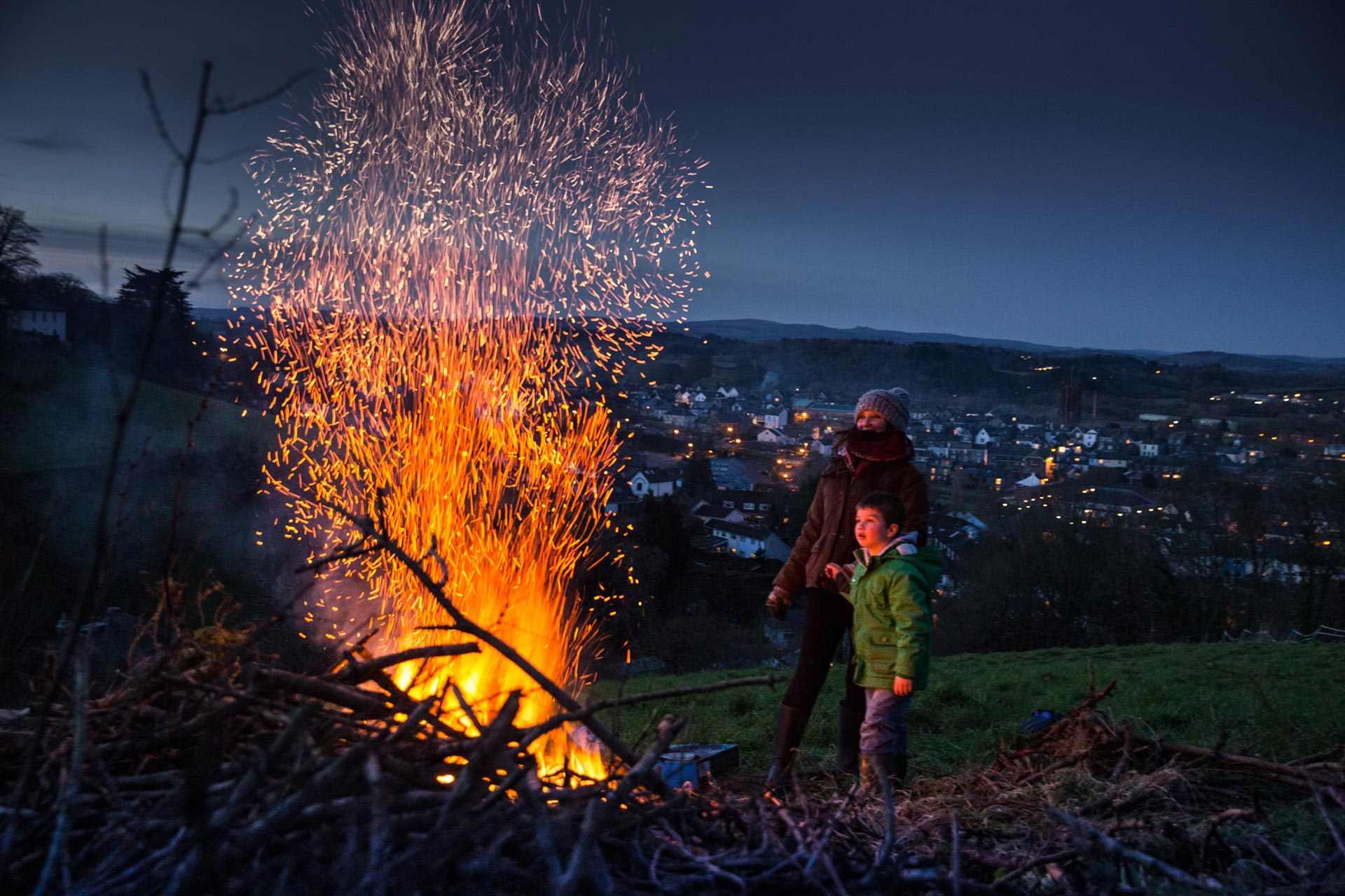 The magic of 5th November – Guy Fawkes Night, or Bonfire Night, is hard to explain to anybody who hasn't grown up in England. The lights of Totnes sparkle behind.