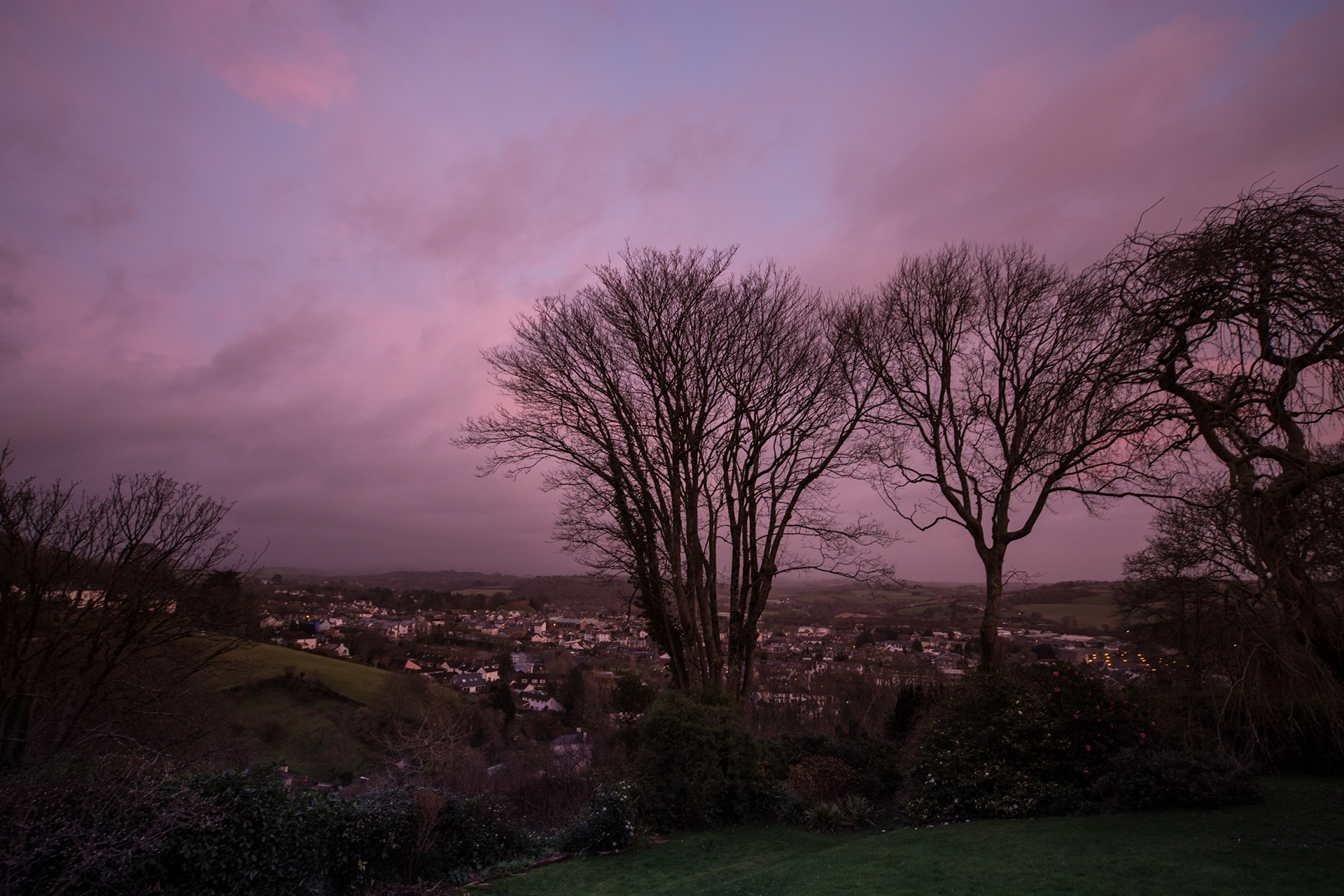 Sunrise set off a stormy sky above Totnes in Devon, England. Dartmoor, which can be seen in the far distance, often has a strong influence upon the weather moving in from the Atlantic, creating a barrier which invites precipitation.