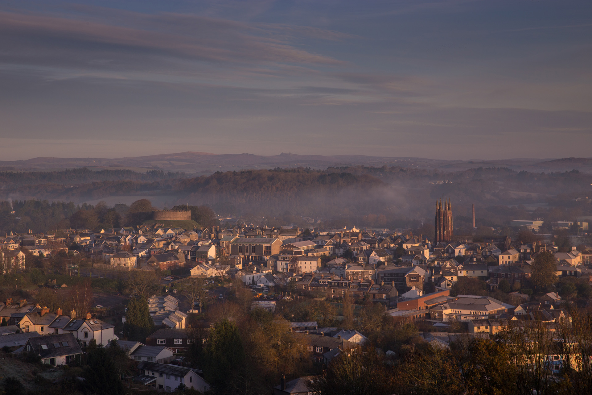 Frosty Winter Morning showing contrasting mediaeval architecture of Totnes and South Devon, behind it Dartington Hall Estate stretches into the forest.