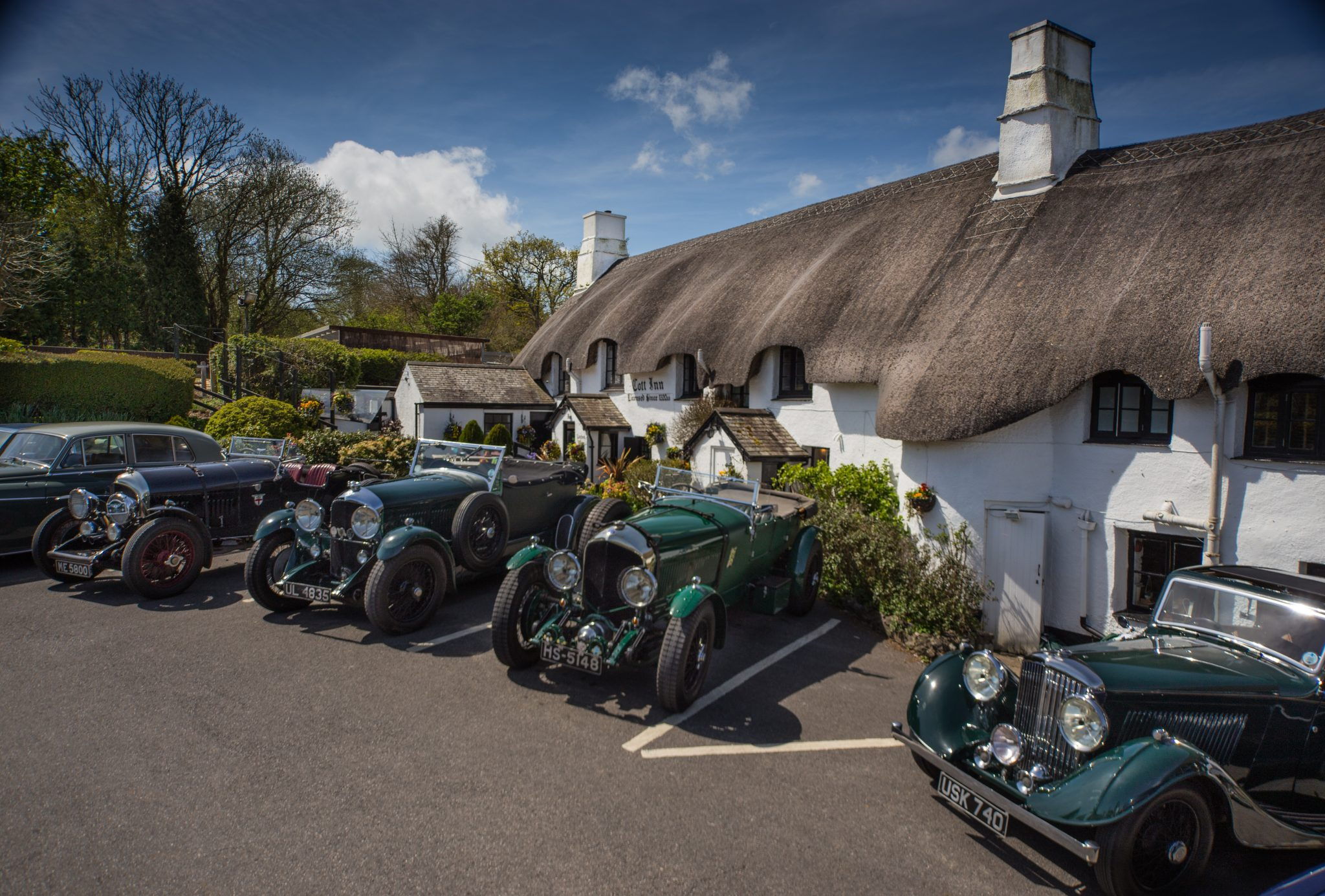 Bentley 3 Litre and Blower Bentley's from The Bentley Owners Club line-up outside The Cott Inn, Dartington, Devon. Britain's oldest Country Inn. Carey Marks Photography