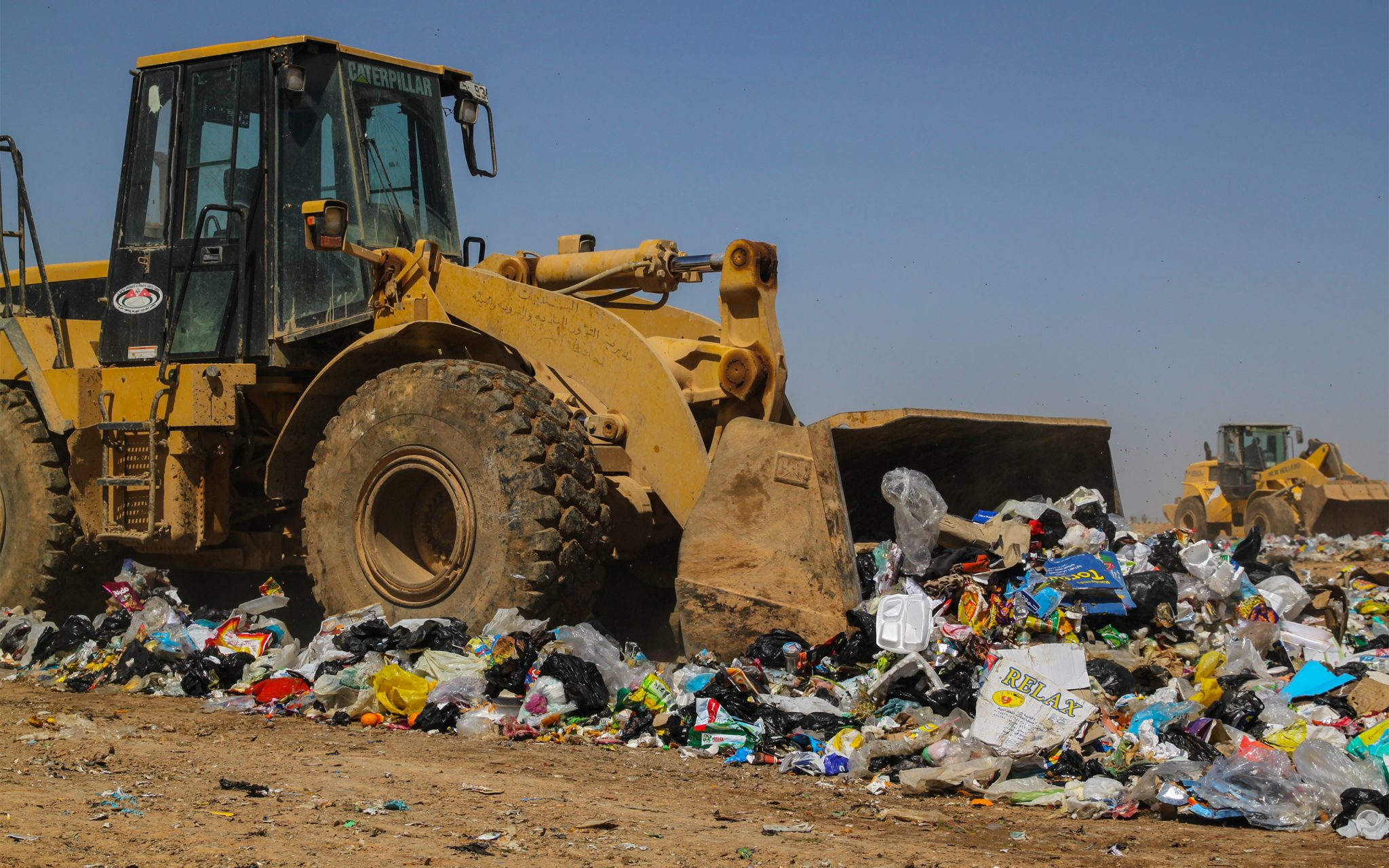 Al Huseyniyat landfill site: the bulldozers 'hammer along' at the speed of knots, while the refugees have to dance between them to avoid being crushed