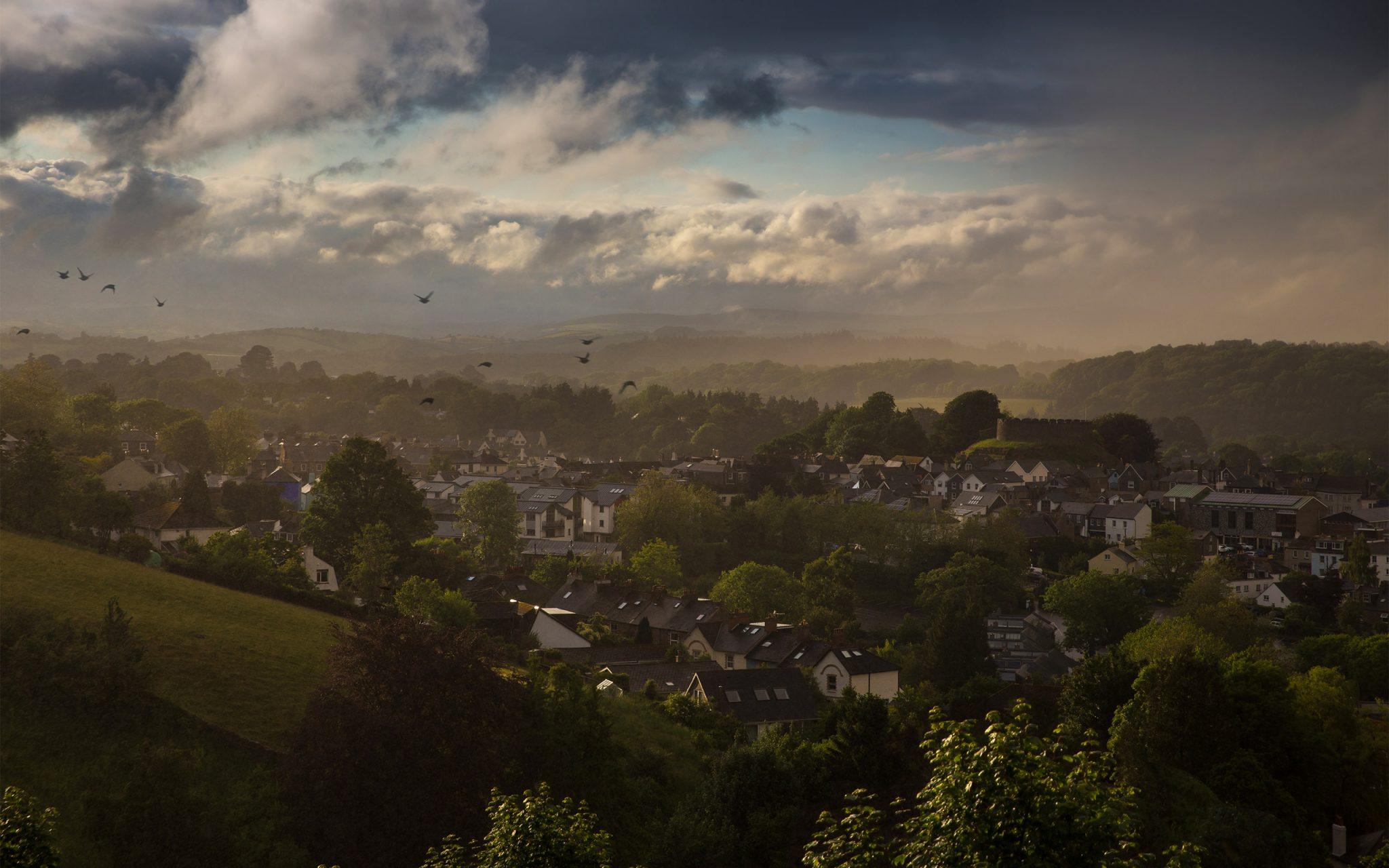 View of totnes in Devon. Sudden flash rain storm. Looking to Dartmoor, the 1000-year old Norman castle.